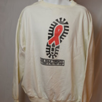 """White sweatshirt reads """"AIDS Walk Toronto: A Pledge is the First Step,"""" with stylized footprint with AIDS ribbon in the centre."""