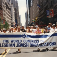 Colour photograph showing a group carring a World Congress of Gay and Lesbian Jewish Organizations banner.